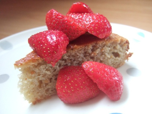 Honey almond cake with macerated strawberries